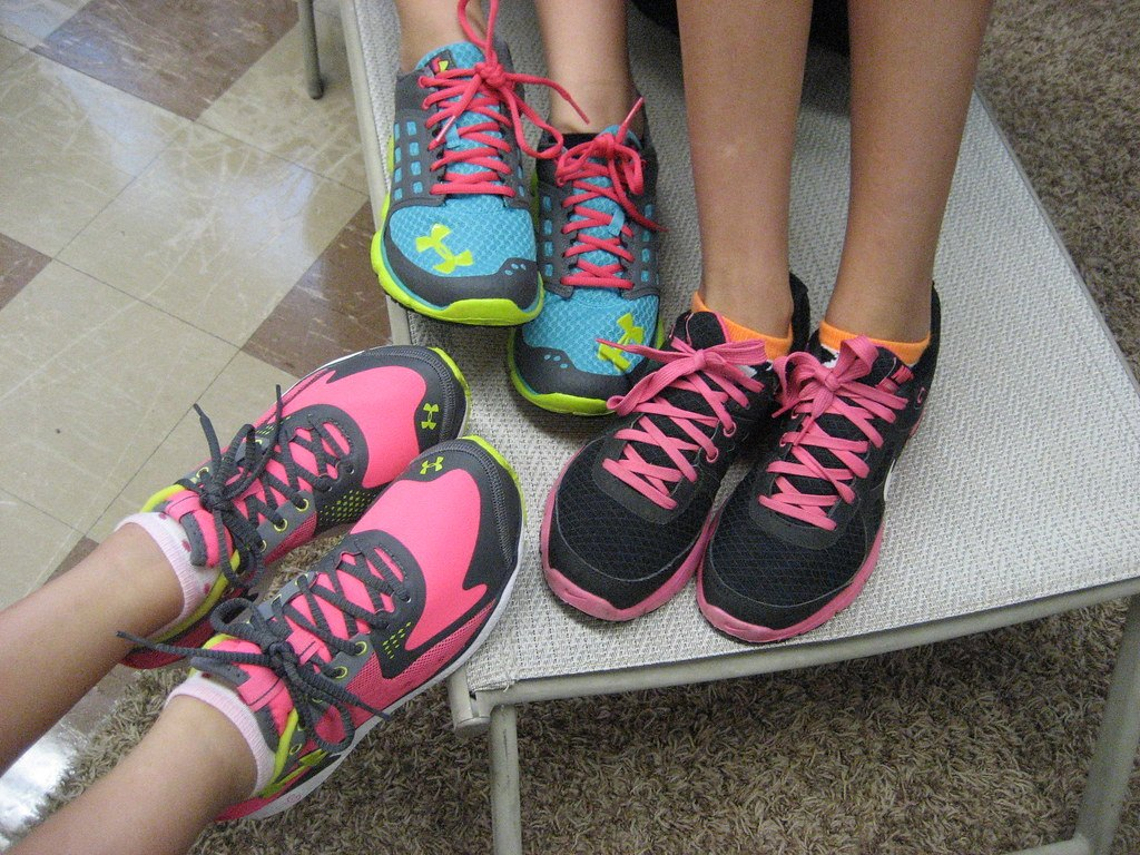Close-Up of Three Women Wearing Ankle Socks and Well-Fitting Pink-Tinged Tennis Shoes